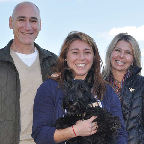The Hoffmans with their dog Buzz