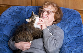 Older woman cuddling with cat