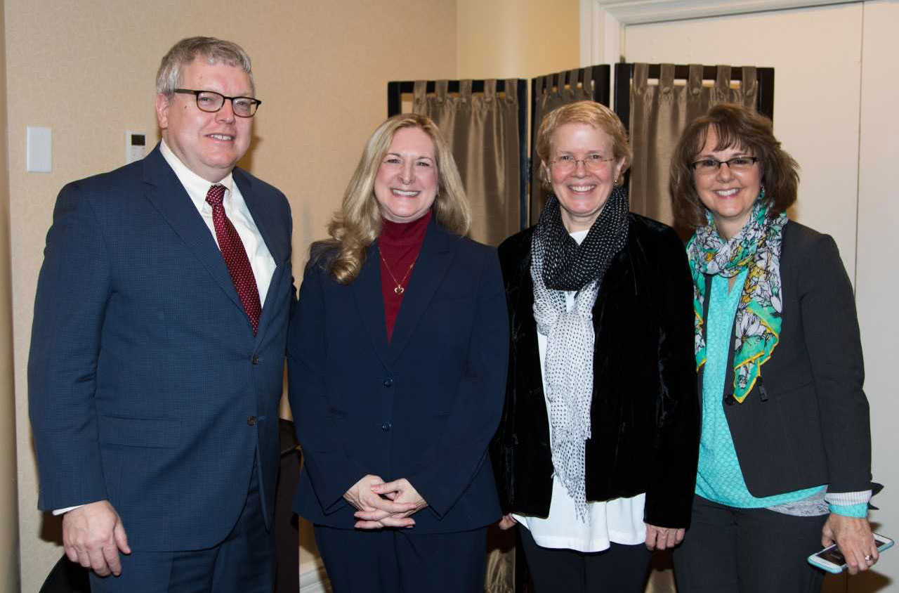 The dean with Carol Merkur and other CVM staff members at the Employee Excellence Awards